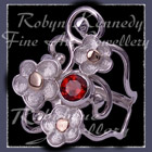10 Karat Yellow Gold, Sterling Silver and Mozambique Garnet 'Feelin' Groovy' Ring Image
