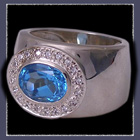 Sterling Silver, Genuine Blue Topaz and Cubic Zirconias Ring Image