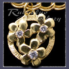 Gold 'Circle of Flowers' Charm with Gemstones Image