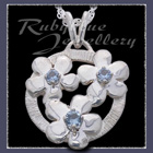 Sterling Silver 'Circle of Flowers' Pendant set with December Birthstones Image