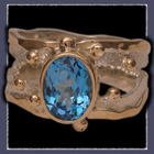 10 Karat Yellow Gold, Sterling Silver and Swiss Blue Topaz  Ring Image