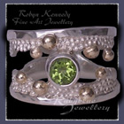 10 Karat Yellow Gold, Sterling Silver and Peridot 'Chic' Ring Image