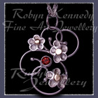 10 Karat Yellow Gold, Sterling Silver and Mozambique Garnet 'Feeling Groovy' Pendant Image