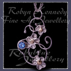 10 Karat Yellow Gold, Sterling Silver and Sky Blue Topaz 'Feeling Groovy' Pendant Image