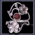 10 Karat Yellow Gold and Sterling Silver 'Feelin' Groovy' Mozambique Garnet Ring Image