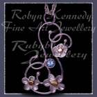 10 Karat Yellow Gold, Sterling Silver and Ice Blue Topaz 'Feeling Groovy' Pendant Image