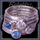 Sterling Silver, Ice Blue Topaz and Swiss Blue Topaz and Swarovski Cubic Zirconias, 'Revelry' Stacker Rings Image