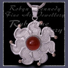 10 Karat Yellow Gold, Sterling Silver and Carnelian 'Sun' Pendant Image