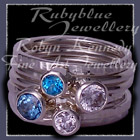Sterling Silver, Teal Topaz, Paraiba Blue Topaz and Sworovski Cubic Zirconias 'Revelry' Stacker Rings Image