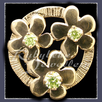 Gold 'Circle of Flowers' Lapel Pin with August Birthstones Image