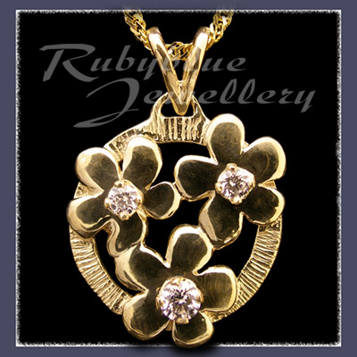 Gold 'Circle of Flowers' Pendant with April Birthstones Image