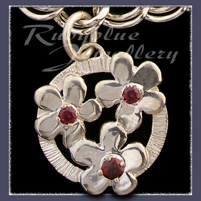 Sterling Silver 'Circle of Flowers' Charm with January Birthstones Image