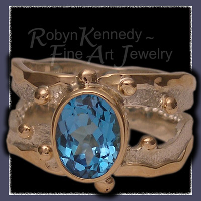 10 Karat Yellow Gold, Sterling Silver and Swiss Blue Topaz 'Blue Lagoon', One-of-a-Kind Ring Image