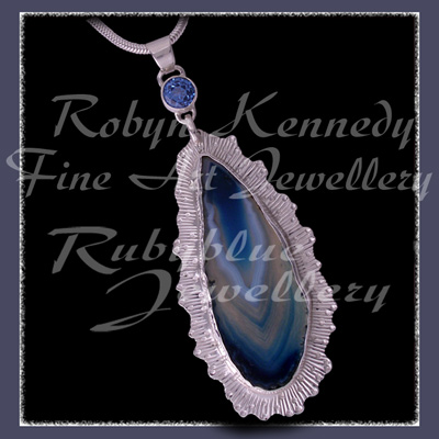 Argentium Silver, Sterling Silver, Blue Lace Agate and Genuine Paradise Blue Topaz 'Blue Crystal Lace' Pendant Image