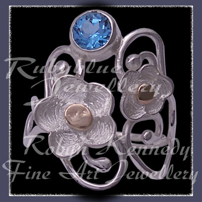 10 Karat Yellow Gold, Sterling Silver and Swiss Blue Topaz 'Feeling Groovy' Ring Image