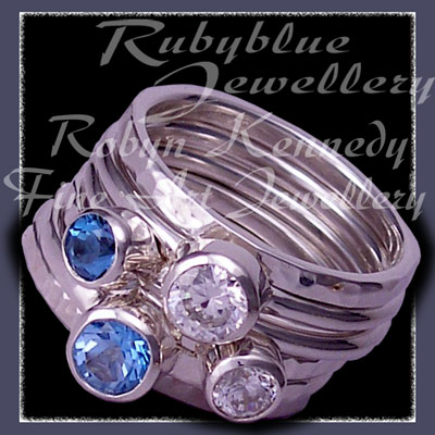 Sterling Silver, Ice and Swiss Blue Topaz and Swarovski Cubic Zirconias, 'Revelry' Stacker Ring Set Image