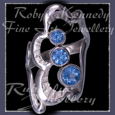 Sterling Silver and Swarovski Ice Blue Topaz 'Past, Present, Future' Ring Image