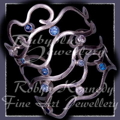 Sterling Silver, Various Blue Topaz' and Cubic Zirconia's 'Seiche' Bangle Bracelet