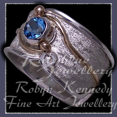 10 Karat Yellow Gold, Sterling Silver and Swiss Blue Topaz 'Serenity' Ring Image