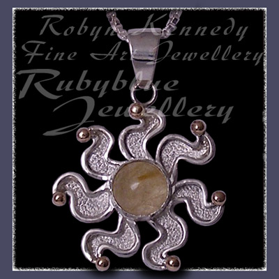 10 Karat Yellow Gold, Sterlling Silver and Rutilated Quartz 'Sun' Pendant Image