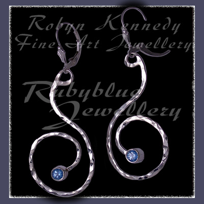 Sterling Silver and Ice Blue Topaz 'Swirls' Earrings Image