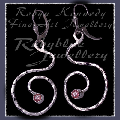 Sterling Silver and Passion Pink Topaz 'Swirls' Earrings Image