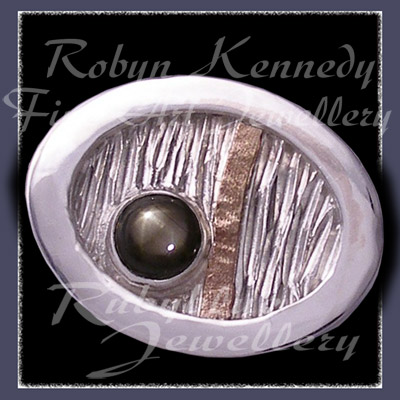 10 Karat Yellow Gold, Sterlium, Sterling Silver and Black Star Sapphire, 'Total Eclipse' Tie Tac Image